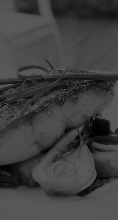 Restaurant seafood dinner with garnish and vegetables (grayscale)